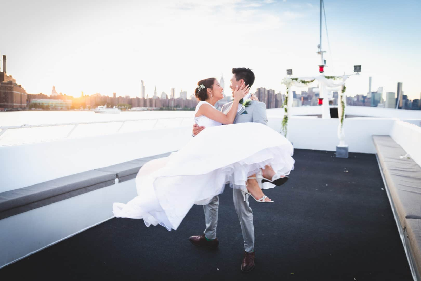 NYC Yacht Wedding with Groom Carrying His Beautiful Bride